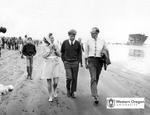 Robert F. Kennedy, Ethel Kennedy, and Robert W. Straub Walk Along the Oregon Coast by Unknown